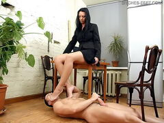 Dominatrix domina punishing and worshipping their slave
